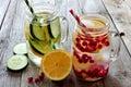 Detox water in mason jar glasses against rustic wood Royalty Free Stock Photo