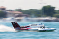 Detroit apba gold cup races july kip brown and the qatar hydroplane pass in front yacht club at the july on the river in Stock Image