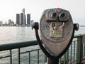 Detroit sightseeing from windsor tourist binoculars overlooking downtown michigan on a summer afternoon ontario canada Royalty Free Stock Image