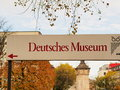 Deutsches museum sign pointing to the in munich Stock Images