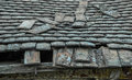 Devastated roof a decrepit old house with a damaged and and tiles Stock Images