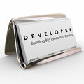 Developer business cards builder software application programmer word on in a holder to advertise your services and network with Royalty Free Stock Image