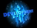 Development on digital background dark blue Stock Photo