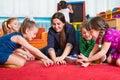 Development games at kindergarten children with tutor plaing Stock Image