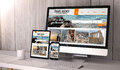 Devices responsive on workspace travel agency online digital generated desktop blank mock up with website screen all screen Royalty Free Stock Images