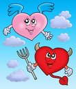 Devil and angel heart on sky Stock Photo