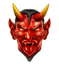 Devil demon halloween monster character with a devilish evil grin as a spooky hot and spicy concept with a red skin horned beast Royalty Free Stock Photos