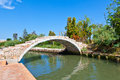 Devil s bridge over a venetian canal fairy tale looking known as the ponte del diavolo or built in bricks on the island of Royalty Free Stock Photo