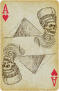Devil spirit playing card with the drawn figure of pharaoh in front of pyramid description drawing consists of at least of two Stock Photos