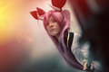 Devil young woman with spear pitchfork hell demon in cloudy sky a girl dressed as or the holds a his hand behind her a covered by Royalty Free Stock Image