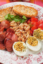 Deviled eggs with beans and sausage rich tasty breakfast plate Royalty Free Stock Photography
