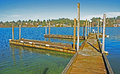 Devils lake dock aging on having two piers with cleats for boat parking in addition to a fishing platform Royalty Free Stock Photos