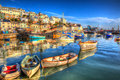Devon boats brixham england uk english harbour with brilliant blue sky summer day and calm sea in colourful hdr Stock Photography