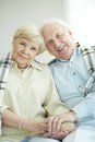 Devoted couple portrait of cheerful senior looking at camera with smiles Stock Image