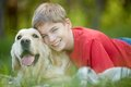 Devoted friends portrait of happy lad with his friendly pet looking at camera Stock Photography