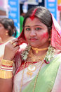 Devotee celebrates durga puja an unidentified woman with red color sindhoor applied on her face during festival on Stock Images