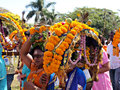 Devotees carrying kavadies at a hindu festival kavady is semi circular structure decorated with flowers etc and is the symbol of Royalty Free Stock Images