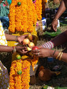 Devotees decorating a kavady at a hindu festival is semi circular structure decorated with flowers etc and is the symbol of the Stock Photos