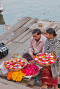 Devotional aids sellers on the ganges varanasi india – march traders banks of hindu sacred river selling flower petals small Stock Photography