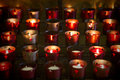 Devotional candles lighting a darkened basilica of the national shrine of mary queen of the universe Royalty Free Stock Image