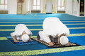 Devout family is prostration in the mosque Royalty Free Stock Photo