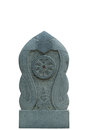 Dharmacakra the wheel of the law stone sculpture isolated Stock Image