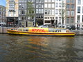 Dhl courier boat in amsterdam april used to deliver parcel through the canals april Royalty Free Stock Photography