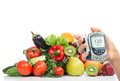 Diabetes concept glucose meter fruits and vegetables in hand healthy organic food organic green apple egg plant orange Stock Photography