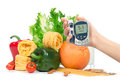 Diabetes concept glucose meter hand healthy organic green red pepper tomatoes almonds fresh salad spaghetti grapefruit glass milk Royalty Free Stock Photos