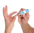 Diabetes lancet in hand finger to make punctures Royalty Free Stock Photo