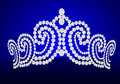 Diadem feminine wedding on turn blue background Royalty Free Stock Photos