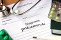 Diagnosis pneumonia  and stethoscope. Royalty Free Stock Photo