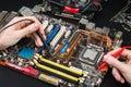 Repair of a broken motherboard Royalty Free Stock Photo