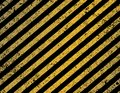 Diagonal black and yellow stripes striped pattern background with distressed texture Stock Photos