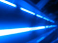 Diagonal blue laser rays bokeh background