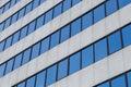 Diagonal glass windows office bulding background Royalty Free Stock Photo