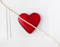 Diagonal heart red with string of pearls framed on white background Stock Photos