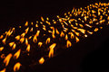 Diagonal of many burning candles inside a buddhist temple Stock Image