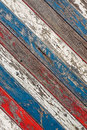 Diagonal old planks painted white red and blue background of weathered in Royalty Free Stock Images