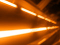 Diagonal orange laser rays bokeh background