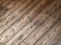 Diagonal texture of old wooden planks with rusty nails Royalty Free Stock Photo