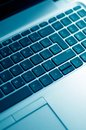 Diagonal View of Blue Toned Laptop Keyboard Royalty Free Stock Photo