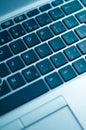 Diagonal View of Blue Toned Laptop Keyboard Royalty Free Stock Photo