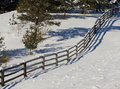 Diagonal wooden rail fence with snow Royalty Free Stock Photography