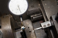 Dial gauge check roundness of part on lathe manual Stock Images