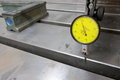 Dial gauge checking the level inside the t slot on the cnc machine Royalty Free Stock Image