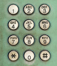 Dial number button on old used public telephone Royalty Free Stock Photo