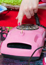 Dialing number on pink phone Royalty Free Stock Photo