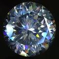 Diamond artificial round brilliant cut at black background Stock Image