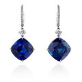 Diamond and blue sapphire earrings. Royalty Free Stock Photo